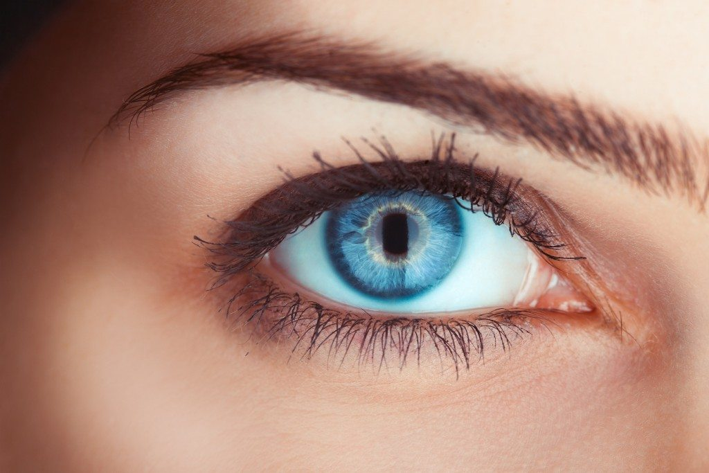 Close up photo of woman's blue eye