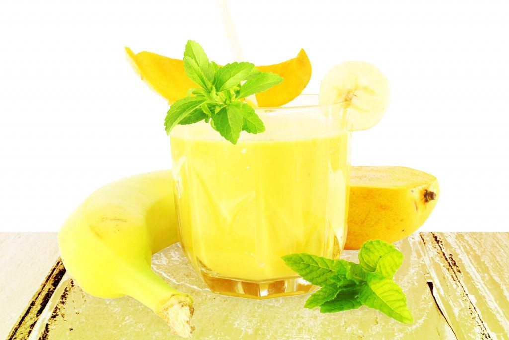 banana mango smoothie with stevia  in pure white background