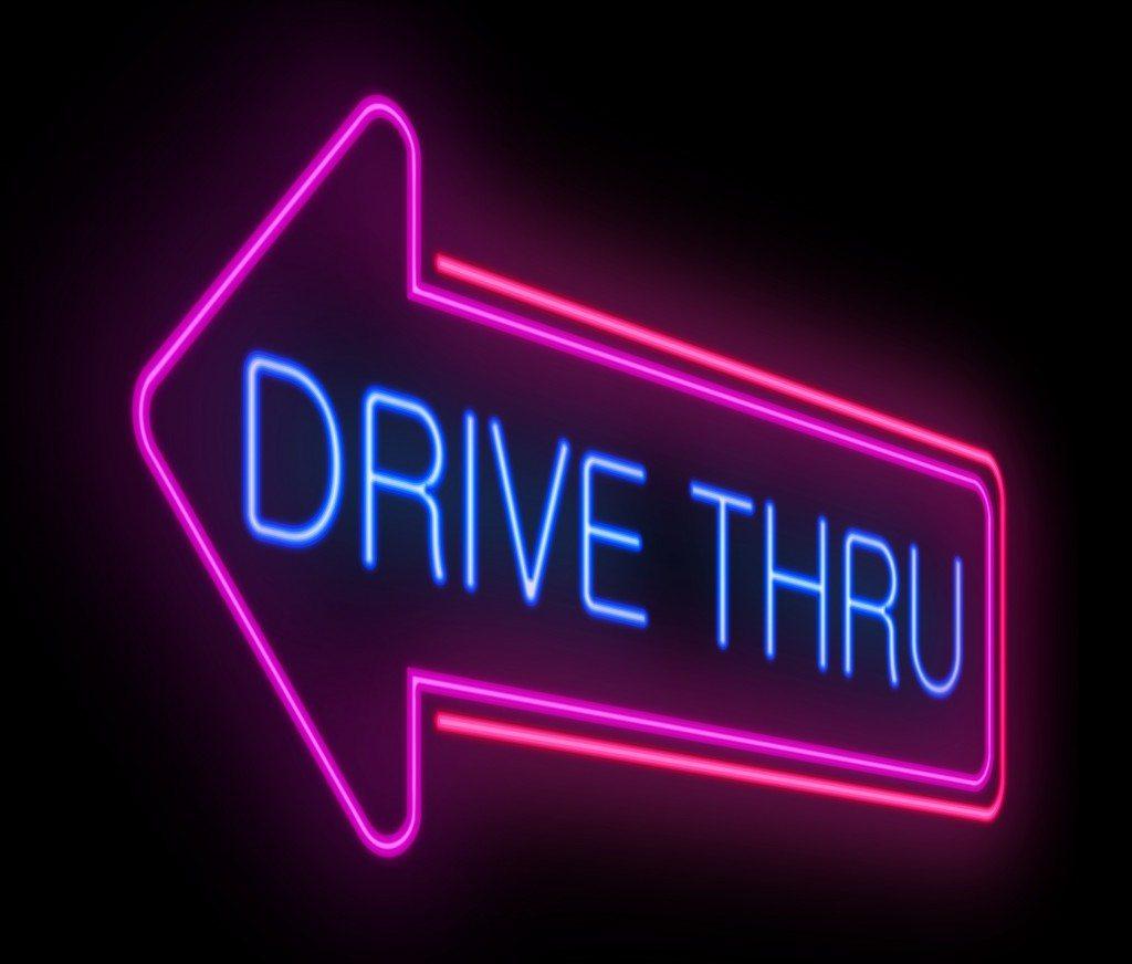 Illustration depicting an illuminated neon drive thru sign.