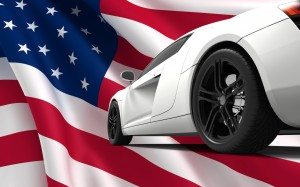 Modern white car isolated on a USA flag